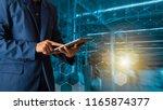 businessman manager using... | Shutterstock . vector #1165874377
