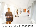 a student from india stands...   Shutterstock . vector #1165895857