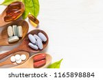 Variety Of Vitamin Pills In...