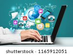 doctor working on laptop at... | Shutterstock . vector #1165912051