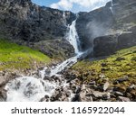 waterfall and stream flowing on ... | Shutterstock . vector #1165922044