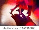man and a woman dancing salsa... | Shutterstock . vector #1165933891