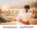 beautiful couple dancing on the ... | Shutterstock . vector #1165953907