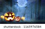halloween pumpkins against... | Shutterstock . vector #1165976584