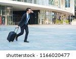 businessman running with... | Shutterstock . vector #1166020477