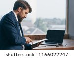 business man in the office... | Shutterstock . vector #1166022247