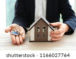 real estate agent with house... | Shutterstock . vector #1166027764