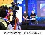 photographer video recording... | Shutterstock . vector #1166033374