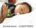 cute baby boy sleeping on the... | Shutterstock . vector #1166070004