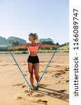 fit woman training shoulders...   Shutterstock . vector #1166089747