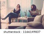 two young happy women friends... | Shutterstock . vector #1166149837