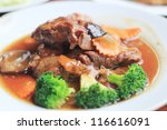 braised pork with vegetables - stock photo