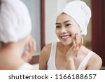 charming asian woman in white... | Shutterstock . vector #1166188657