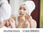 young asian woman in towel... | Shutterstock . vector #1166188681