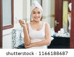 young cheerful asian woman with ... | Shutterstock . vector #1166188687