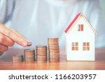 saving money concept man hand... | Shutterstock . vector #1166203957
