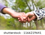 closeup of two school girls who ... | Shutterstock . vector #1166219641
