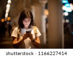 young woman use smartphone on... | Shutterstock . vector #1166227414