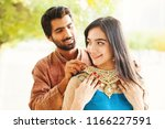 indian man gifting jewelry to... | Shutterstock . vector #1166227591