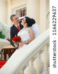 the bridegroom embraces the...   Shutterstock . vector #1166229637