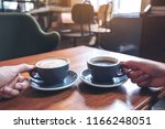 closeup image of two people's... | Shutterstock . vector #1166248051