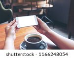 mockup image of hands holding... | Shutterstock . vector #1166248054