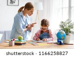 mother scolds a child for poor... | Shutterstock . vector #1166258827