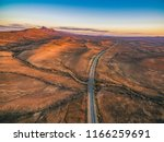 the outback highway passing... | Shutterstock . vector #1166259691
