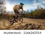 mountain biker on forest trail. ...   Shutterstock . vector #1166262514