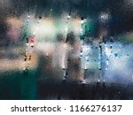raindrop on glass window in... | Shutterstock . vector #1166276137