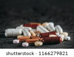 a capsules tablets on table | Shutterstock . vector #1166279821
