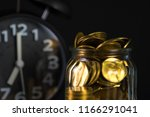 coins stacks with coin in glass ... | Shutterstock . vector #1166291041