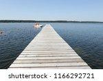 wood pier pontoon on the lake   Shutterstock . vector #1166292721