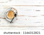 top view of cappuccino cup on...   Shutterstock . vector #1166312821