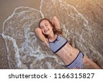 happy laughing young girl on... | Shutterstock . vector #1166315827