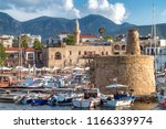 defence chain tower in harbour... | Shutterstock . vector #1166339974