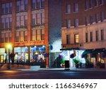 upscale urban street at... | Shutterstock . vector #1166346967