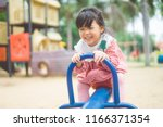 asian child girl playing on... | Shutterstock . vector #1166371354