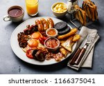 full fry up english breakfast... | Shutterstock . vector #1166375041