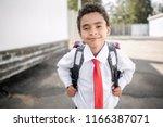 elementary school student with... | Shutterstock . vector #1166387071