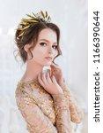 woman in golden evening gawn... | Shutterstock . vector #1166390644