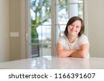 down syndrome woman at home... | Shutterstock . vector #1166391607