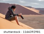 young asian man traveler and... | Shutterstock . vector #1166392981