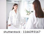 portrait of calm pretty girl... | Shutterstock . vector #1166393167
