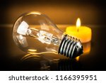 halogen bulb and candle | Shutterstock . vector #1166395951