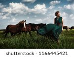 beautiful blond woman in a long ... | Shutterstock . vector #1166445421