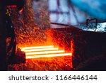 hot steel on conveyor in steel... | Shutterstock . vector #1166446144