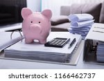 close up of piggybank and... | Shutterstock . vector #1166462737