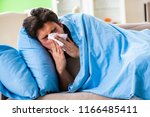 sick young man suffering from... | Shutterstock . vector #1166485411