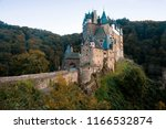 burg eltz castle at sunset.... | Shutterstock . vector #1166532874